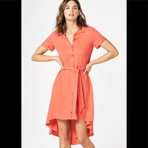 A high low shirt dress with a button down closure